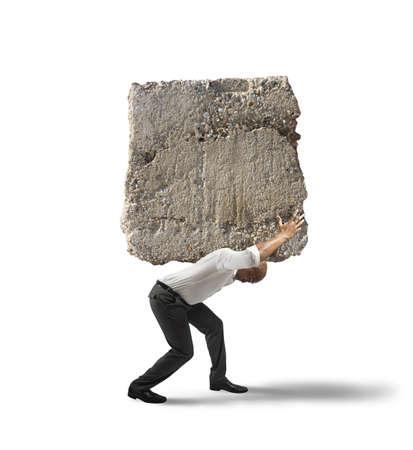Foto de Concept of stress of a businessman with a big rock - Imagen libre de derechos