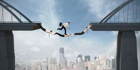 Photo pour Teamwork concept with running businessman over the bridge - image libre de droit