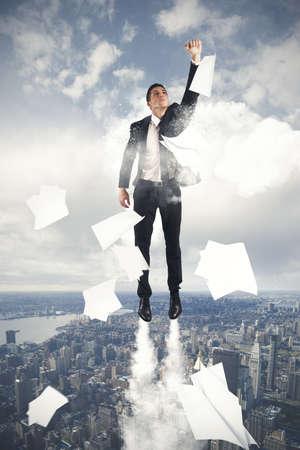 Foto de young businessman flying in the sky - Imagen libre de derechos
