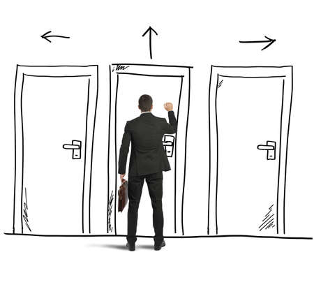 Photo for Businessman opens a door designed in a wall - Royalty Free Image