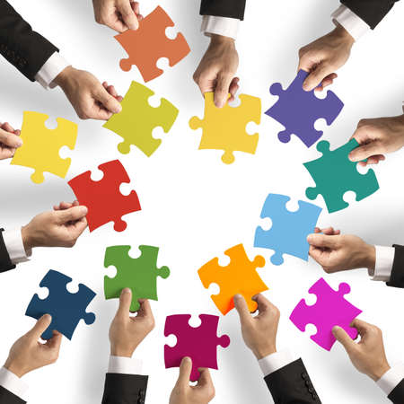 Foto de Teamwork and integration concept with puzzle pieces - Imagen libre de derechos