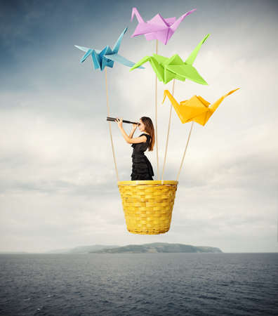 Foto de Girl searching for new fashions with origami - Imagen libre de derechos