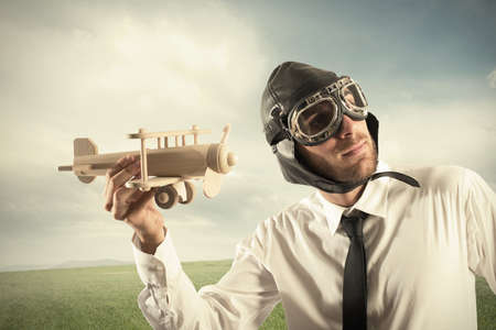 Photo pour Concept of business in action with businessman with a airplane - image libre de droit
