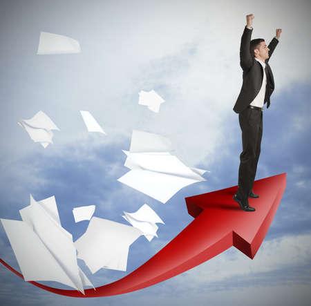 Foto de Success of a businessman with positive statistics - Imagen libre de derechos