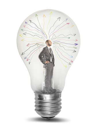 Foto de Concept of genius businessman tkinking  in a light bulb - Imagen libre de derechos