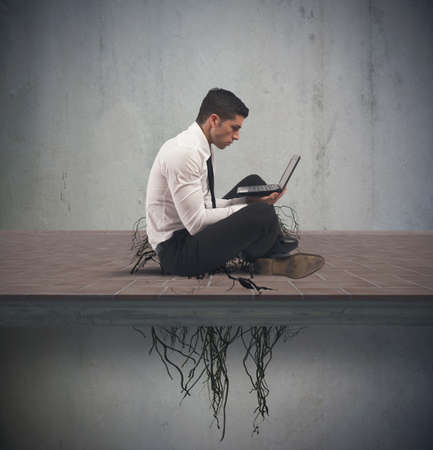 Photo pour Concept of internet addiction with businessman with root - image libre de droit