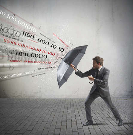 Photo pour Antivirus and firewall concept with businessman and umbrella - image libre de droit