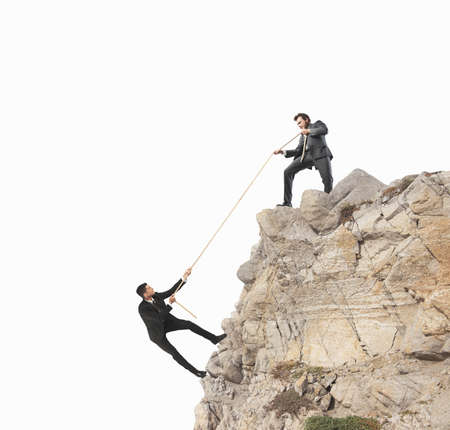 Photo pour Concept of teamwork with climbing businessman - image libre de droit