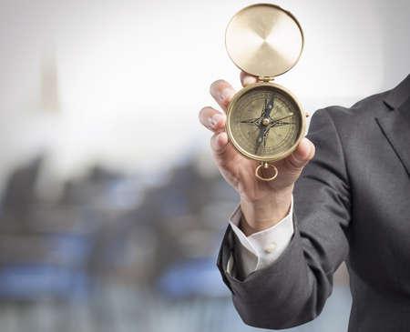 Foto de Concept of orientation in the business with businessman and compass - Imagen libre de derechos