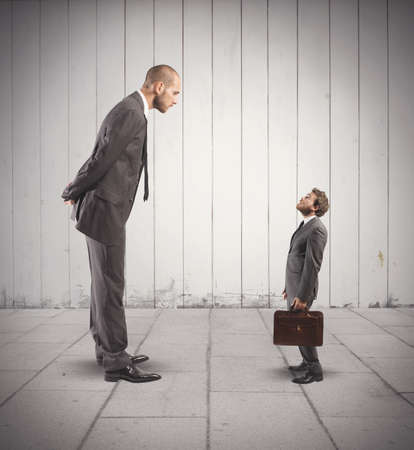 Photo pour Concept of business competition with big and small businessmen - image libre de droit