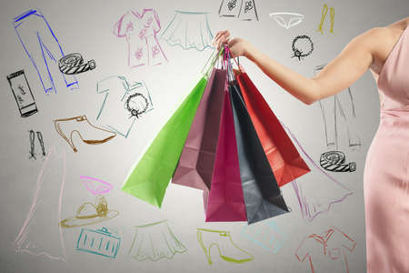 Photo pour Shopping concept with several colorful shopping bags and drawing - image libre de droit