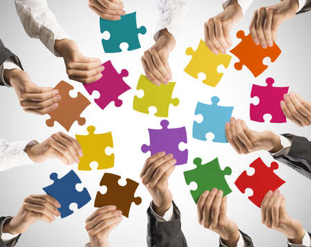 Photo for Concept of teamwork and integration with businessman holding colorful puzzle - Royalty Free Image