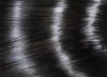 Photo pour Fashion background with long shiny black hair - image libre de droit
