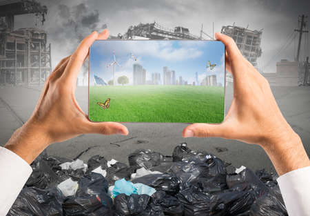 Photo for Concept of sustainable development with green vision in a tablet - Royalty Free Image