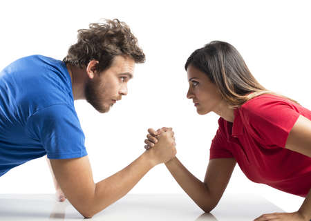 Photo for Arm wrestling challenge between a young couple - Royalty Free Image