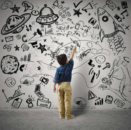 Foto de Concept of small genius with kid and varius drawings - Imagen libre de derechos
