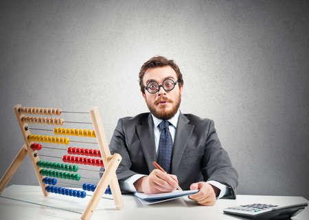 Foto de Concept of nerd with financial businessman with calculator - Imagen libre de derechos