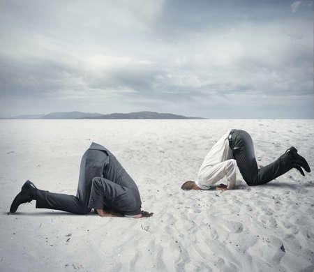 Foto de Concept of fear of crisis with businessman like an ostrich - Imagen libre de derechos