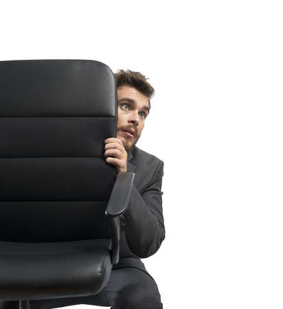 Photo for Concept of fear of a businessman behind a chair - Royalty Free Image