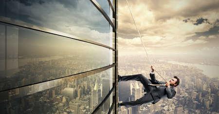 Photo pour Concept of Climb to the success with climbing businessman - image libre de droit