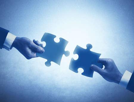 Photo pour Concept of business teamwork and integration with puzzle - image libre de droit