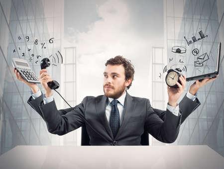 Photo pour Concept of busy multitasking businessman at work - image libre de droit