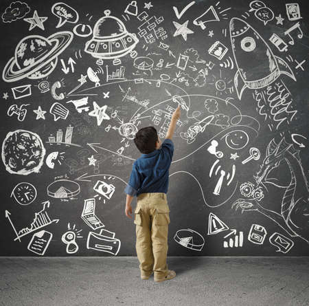 Foto de Concept of small genius with kid and varius drawings - Imagen libre de derechos