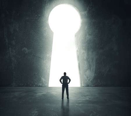 Photo pour Concept of success with businessman looking through key hole - image libre de droit