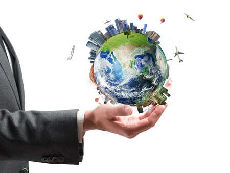 Foto de Concept of business power. Businessman holds modern World - Imagen libre de derechos