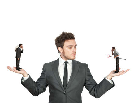 Photo for Businessman confused between being good or bad - Royalty Free Image