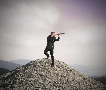 Photo pour Concept of business vision with businessman with telescope - image libre de droit