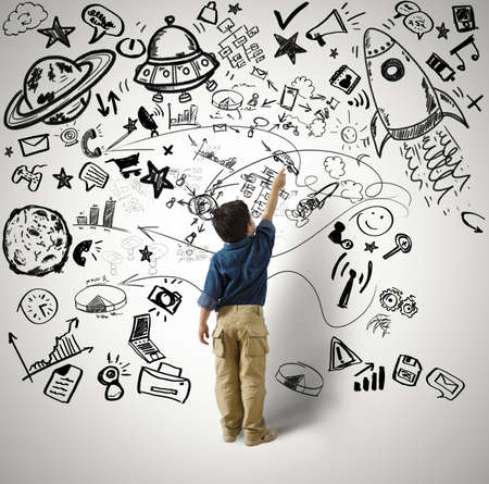 Photo pour Concept of small genius with kid and varius drawings - image libre de droit