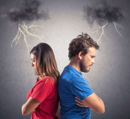 Foto de Problem of a young couple with blacks clouds and lightning - Imagen libre de derechos