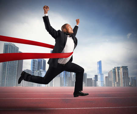 Photo for Success of a businessman in a finishing line - Royalty Free Image