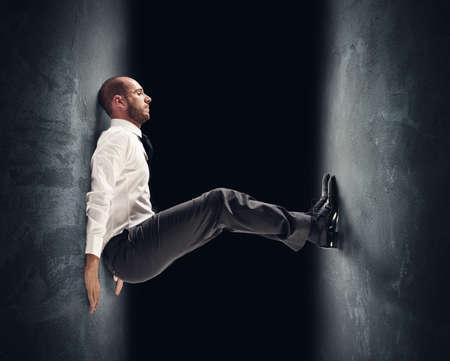 Photo pour Concept of a stressed businessman under pressure - image libre de droit
