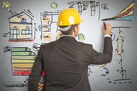 Foto de Engineer that calculates the energy efficiency of a house - Imagen libre de derechos