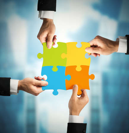 Photo pour Businessman with puzzle. Concept of teamwork and partnership concept - image libre de droit
