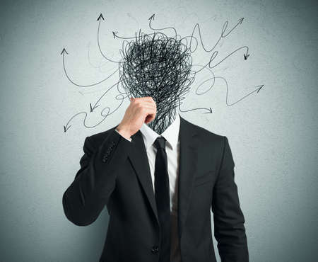 Foto de Confused businessman with arrows and lines in head - Imagen libre de derechos