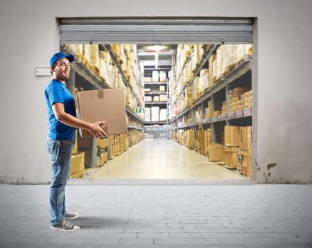 Photo pour Courier to work in the warehouse logistics - image libre de droit