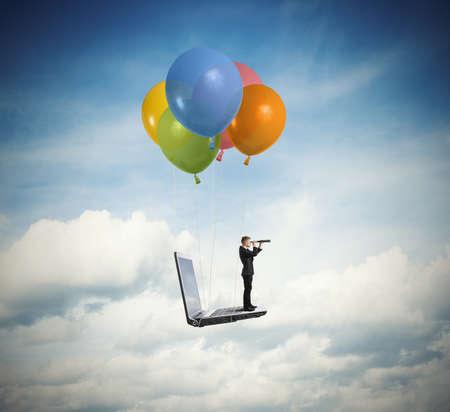 Photo pour Businessman looking for new business over a laptop - image libre de droit