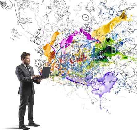 Foto de Businessman working with a laptop with a creative idea - Imagen libre de derechos
