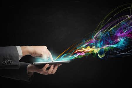 Foto de Businessman working with creative touch screen tablet - Imagen libre de derechos