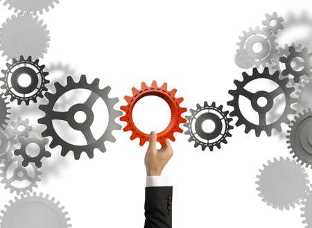 Foto de Businessman builds a business system with gear - Imagen libre de derechos