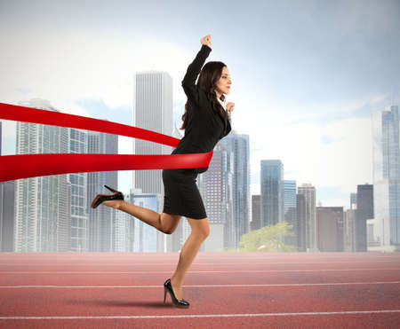 Photo for Concept of winner businesswoman in a finish line - Royalty Free Image