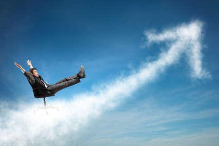 Photo pour Successful businessman over a cloud like an arrow - image libre de droit