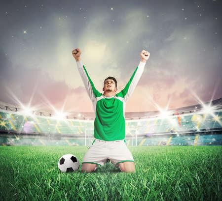 Foto de Concept of victory with soccer player cheering - Imagen libre de derechos