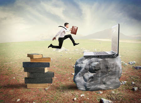 Photo for Concept of technology migration with businessman jumping from book to laptop - Royalty Free Image