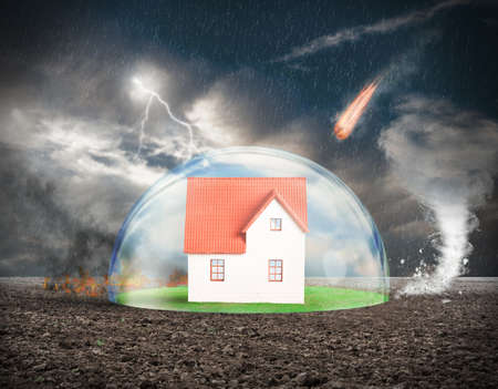Foto de Concept of home protection insurance with crystal sphere - Imagen libre de derechos
