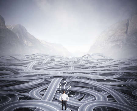 Photo pour Concept of a businessman in front of a confusion of road - image libre de droit