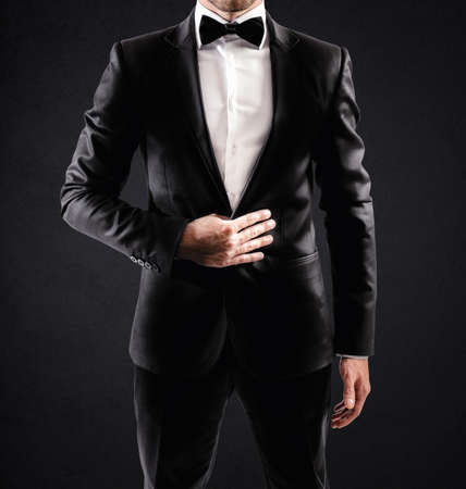 Photo for Sexy elegant businessman with bow tie and white shirt - Royalty Free Image